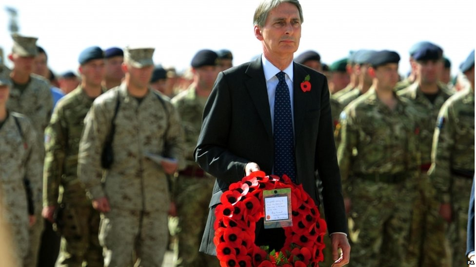 Phil Hammond laying a wreath at Camp Bastion